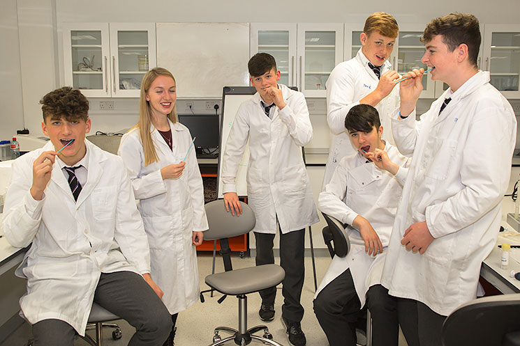 Biochemistry undergraduate, Carolyn Murray, teach this group of secondary school students from Presentation Brothers College, Cork to swab to collect their cheek cells which they then use in the DNA extraction experiment they run during the DNA workshop.