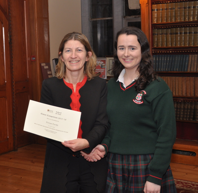 Vivian Forde being presented with a certificate by Professor Ursula Kilkelly