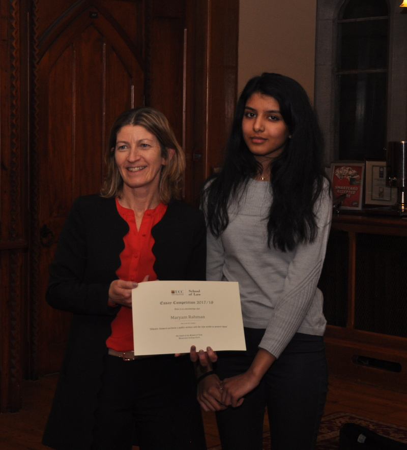 Maryam Rahman being presented with a certificate by Professor Ursula Kilkelly