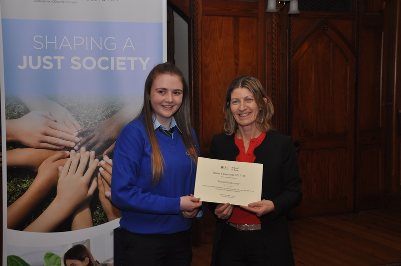Sinead McWeeney being presented with a certificate by Professor Ursula Kilkelly