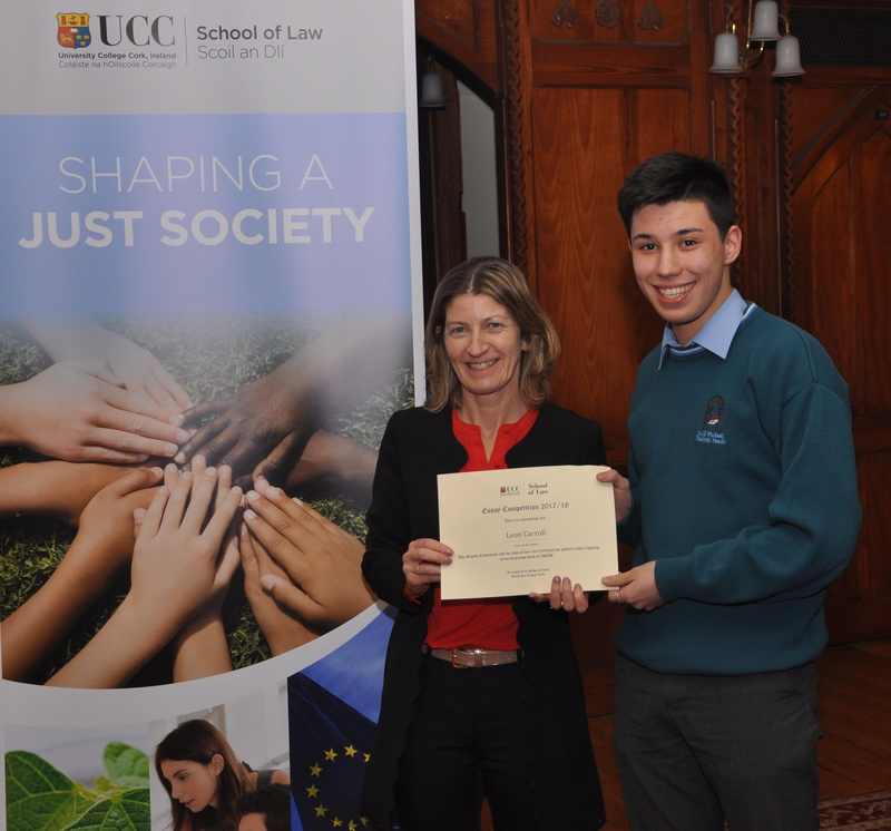 Leon Carroll being presented with a certificate by Professor Ursula Kilkelly