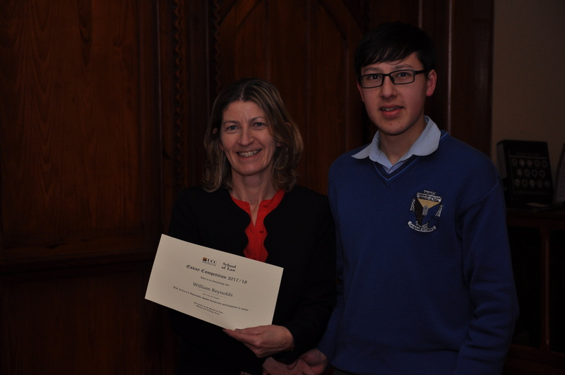 William Reynolds being presented with a certificate by Professor Ursula Kilkelly