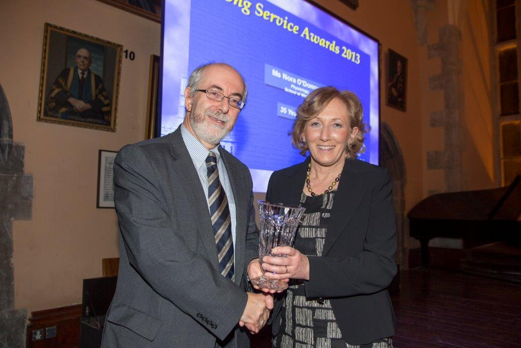 Nora O'Donovan being presented with her 35 year award by Registrar Prof.Paul Giller