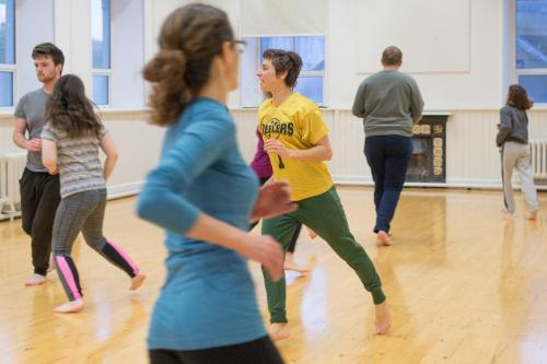 Students running in their theatre class