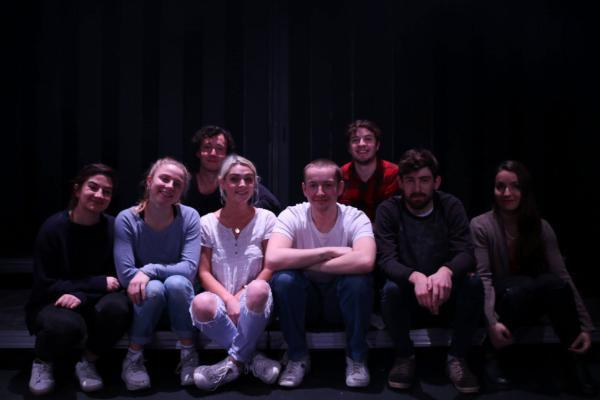 Cast and Crew of Disco Pigs pose for a photo on stage