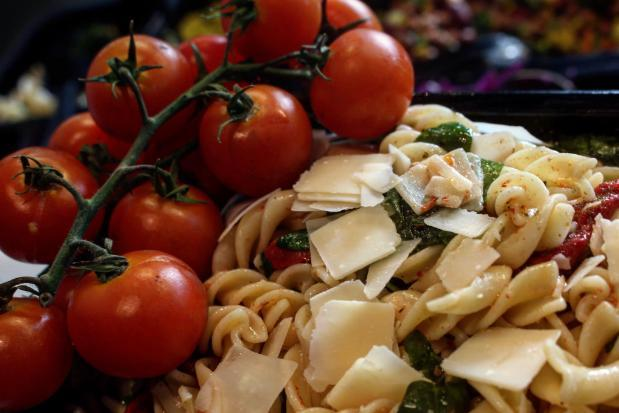 cherry tomatoes on a bed of pasta