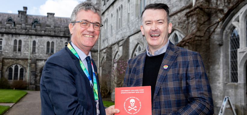 Deputy President & Registrar Professor John O'Halloran presents Cork hurling legend Dónal Óg Cusack with the recently launched UCC Sports Strategy