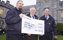 UCC Security Services present cheque to Marymount Hospice